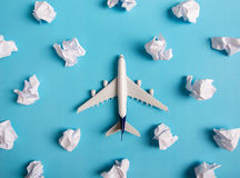 Airplane model flying among paper clouds. Airplane model flying among paper clouds, Traveling concept Stock Image