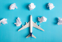 Airplane model flying among paper clouds. Airplane model flying among paper clouds, Traveling concept Stock Photography