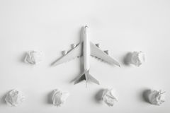 Airplane model flying among paper clouds. Airplane model flying among paper clouds, Traveling concept, on white background Stock Photography