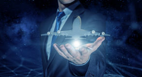 Airplane model in palm . Mixed media stock photo