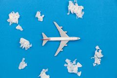 Airplane model with paper ball Instead of white clouds on blue b Royalty Free Stock Photos