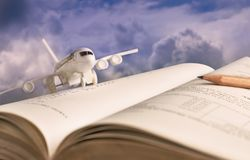 Airplane model on textbook or hardback. The concept of tourism. On holiday or traveling for business royalty free stock photography