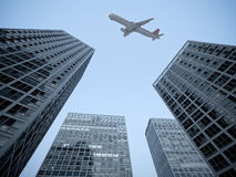Airplane and modern building Royalty Free Stock Images