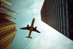 Airplane and modern building stock image