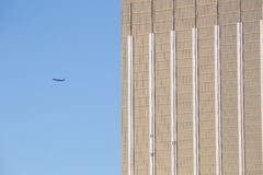 Airplane with modern building Stock Photo