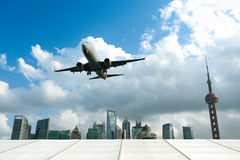 Airplane with modern city Royalty Free Stock Photo