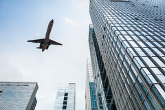Airplane and modern office building Stock Image