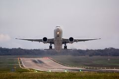 Airplane moments after takeoff, with beautiful environment. Leaving runway behind royalty free stock photo
