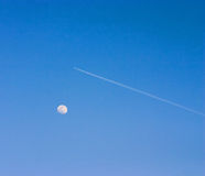 Airplane and Moon. An airplane flying over the moon royalty free stock photos