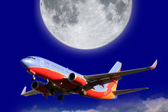 Airplane and moon. Airplane flying, moon, dark blue sky Stock Photo