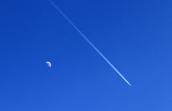 Airplane and moon Stock Images