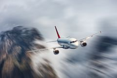 Airplane in motion. Aircraft with motion blur effect is flying i Royalty Free Stock Image