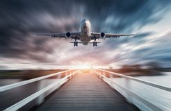 Airplane in motion with blurred background Royalty Free Stock Image