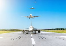 Airplane moves down the runway after landing in the background in the sky turn from passenger aircraft calling at landing at the a. Irport Royalty Free Stock Photo
