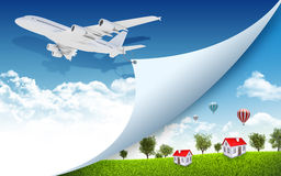 Airplane with nature landscape and houses Royalty Free Stock Photos