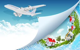 Airplane with nature landscape and houses Stock Photo