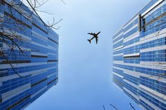 Airplane Near Blue and Grey Building Stock Photos
