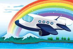 An airplane near the rainbow Royalty Free Stock Photo