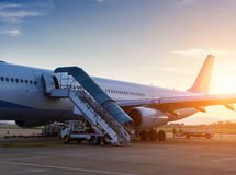 Airplane near the terminal Royalty Free Stock Images