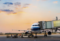 Airplane near the terminal in an airport Royalty Free Stock Photography