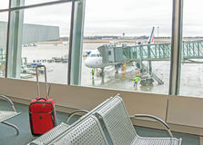 Airplane is near the terminal. Close up of luggage. royalty free stock photos