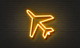 Airplane neon sign on brick wall background. Royalty Free Stock Photography