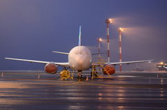 Airplane at night Stock Image