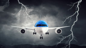 Airplane in night sky. Mixed media. Airliner flying in night dark stormy sky. Mixed media Royalty Free Stock Photography