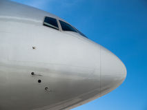 Airplane nose. Against clear blue sky Stock Photos