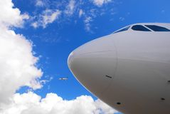 Airplane nose. Details against clear blue sky Stock Photography