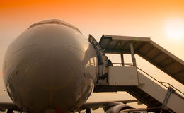 Airplane nose and passanger stairs Stock Images