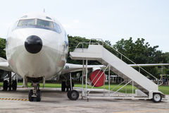 Airplane nose with passenger stairs Stock Photo