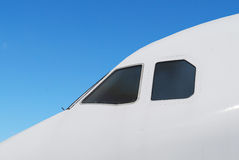 Airplane nose. White airplane nose on blue sky background Stock Photography