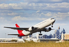 Airplane Off Against CBD Stock Image