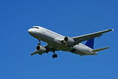 Airplane On Blue Sky Royalty Free Stock Photography