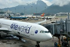 Airplane with `one world` mark in Hongkong Airport Royalty Free Stock Photography