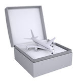 Airplane in open gift box Stock Photos
