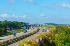 Airplane over autobahn Stock Image