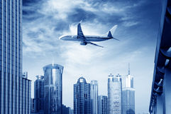 Airplane over the city Royalty Free Stock Photo