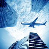 Airplane over the city Royalty Free Stock Images