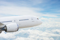 Airplane over clouds Royalty Free Stock Photos