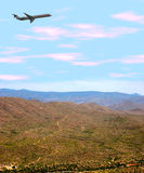 Airplane Over Desert. Airplane flying over Arizona desert and mountains. Shot with a Canon 20D stock photos
