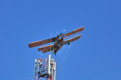 Airplane over GSM Antenna Royalty Free Stock Photo