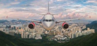 Airplane over Hongkong island Royalty Free Stock Photos