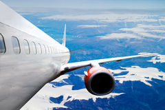 Airplane over Iceland Stock Image