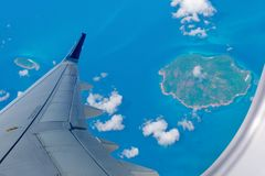 Airplane over Indonesian islands stock photography