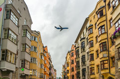 Airplane over Innsbruck's buildings. Austria stock images
