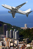 Airplane over Ipanema beach in Brazil. Airplane over Rio De Janeiro city in Brazil Royalty Free Stock Photography
