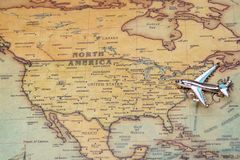 Airplane over a map of North America close-up. royalty free stock photography