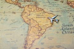 Airplane over the map of South America. Toy airplane on the map background royalty free stock photo